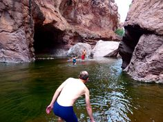 Greg Koerper, of Corvallis, Ore., prepares to follow his wife, Patricia Berman, and guide Salvador Castro Drew into the canyon waters to reach cave paintings at La Trinidad Cave, near Mulege, Baja California Sur, in Mexico. (Brian J. Cantwell / The Seattle Times)