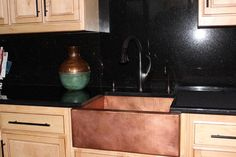 We love this baby Matte Copper farmhouse sink up against the black countertop and backsplash. A nice mix of warm and cool tones! Photo kindly provided by a valued CopperSinksOnline.com customer