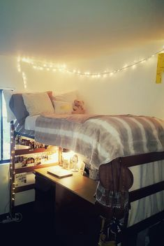 Cozy dorm set up! Soft cream fuzzy planket, light brown throw, Christmas lights, and a bunch of fluffy pillows. Perfect for chilling and calming down in a crazy dorm! #FluffyPillow Brown Throws, Bed Lights, Fluffy Pillows, Chilling, Christmas Lights, Canopy, Dorm, Cream, Christmas Fairy Lights