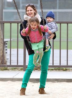 Jennifer Garner gives daughter Seraphina, 4, a hearty push on the swings as she totes tiny tot Samuel, 12 months, at a park in the Pacific Palisades, Calif. on St. Patrick's Day, Sunday, March 17.