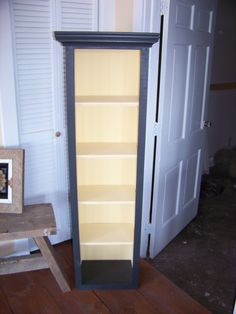 "Book shelf, dvd/cd storage. This one is a very pale yellow inside with a deep dark green almost black.I can build it to any size and color you would like. This one is about 4' H x 1' Wx 8"" deep and sells for $145.00 + shipping."