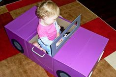 Step by step instructions for how to make a car from three cardboard boxes (and a lot of adult effort to get these results....)