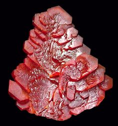 large hoppered crystal of reddish-orange Vanadinite