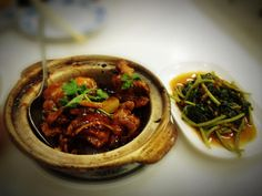 rice wine chicken in a claypot and stir-fried sweet potato leaves
