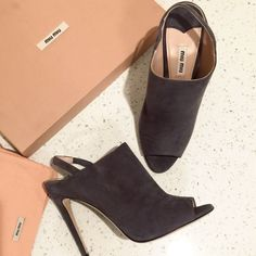 New Miu Miu, 100% Authentic New gray, suede Miu Mui open toe and heal booties, 100% Authentic. Come with the the box and the dustbag. Fit size 7-8. Super stylish. Make for a perfect Christmas gift to yourself or a loved one :) Miu Miu Shoes Ankle Boots & Booties