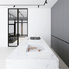 Just love this modern monochrome kitchen by @emildervish new angle showing off that amazing track lighting and can we take a moment to check out that tap...