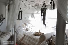 A whimsical garden inspired bedroom with sheers, branches and lanterns  / 9 - A tour of Lucketts Design House via http://www.funkyjunkinteri...