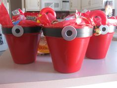 """""""Santa Pants"""" filled with goodies ~ Planter painted red, the black stripe is electrical tape with a washer hot glued on"""