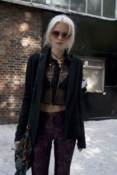Ashley - her clothing style should get progressively darker throughout the books.