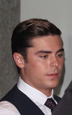 A dapper looking Zac Efron leaves his hotel in central London on April 23, 2012