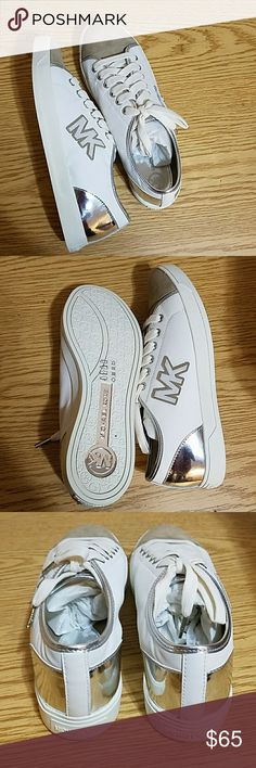 Michael Kors Logo Sneaker Size 9 1/2M MK Sneaker with Tan logo. Suede and leather material. Great condition and never worn. MICHAEL Michael Kors Shoes Sneakers