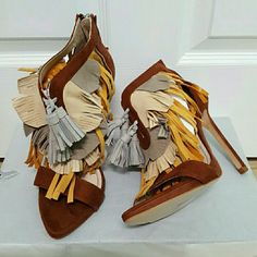 Zara shoes (6612) New with tag. EUR 36 US 6. Upper 80% polyurethane 20% Goat leather. Lining 65% polyurethane 35% polyester. Sole 100% Styrene Butadiene Rubber.  Fringed sandals. Combined color fringe detail. Zip at the back of the heel. Stiletto heel  Height 11cm Zara Shoes Sandals