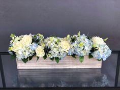 Long wood box arrangement for a table with white roses and blue hydrangeas Blue Hydrangea Centerpieces, Blue Flower Arrangements, Wedding Flower Arrangements, Wedding Bouquets, Floral Wedding Decorations, Flower Decorations, Wedding Centerpieces, Farmhouse Table Centerpieces, Wedding Table