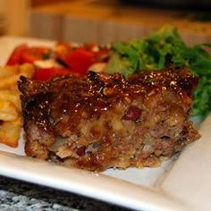 This meatloaf's flavor is enhanced with beef bouillon and a brown sugar glaze with a hint of lemon juice.