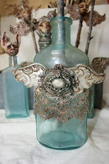 Bottle addiction... polymer clay wings, plaster casting of crusty old broach.