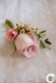 Dusky pink rose buttonhole with spray roses and waxflower