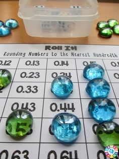 This FREE rounding game worked great in my math centers!  The game board for rounding decimals to the nearest hundredth was excellent practice for both my 5th graders and 6th graders.