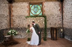 Stunning image of our bride and groom at Cissbury Barn by, Sarah Wenban, of our copper pipe arch decorated with foliage, glass baubles and a bit of extra sparkle from fairy lights. Wedding Altars, Ceremony Backdrop, Fairy Lights, Arches, Backdrops, Dream Wedding, Groom, Copper, Barn