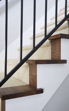 The stairway of this modern farmhouse was completely transformed with a herringbone runner and custom iron railing. The treads and risers were stained to match the new hickory floors by Jillian Lare Interior Design. Farmhouse Stairs, Farmhouse Flooring, Farmhouse Fireplace, Modern Farmhouse, Farmhouse Style, Decor Interior Design, Interior Decorating, Staircase Runner, Stair Runners