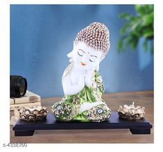 Checkout this latest Idols & figurines_500-1000 Product Name: *Stylish Designer Home Decor* Material: Resin And Marble  Size (L X W X H):  24 cm x 11 cm x 20 cm Description:  It Has 1 Piece Of Baby Buddha statue Country of Origin: India Easy Returns Available In Case Of Any Issue   Catalog Rating: ★4.3 (248)  Catalog Name: Diva Stylish Designer Home Decor Vol 7 CatalogID_622444 C127-SC1615 Code: 274-4338160-8811