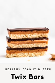 Incredible, healthy peanut butter twix bars made with better-for-you ingredients like all natural peanut butter, almond flour, pure maple syrup, and chocolate. They're perfectly sweet with three delicious layers for a homemade take on your favorite candy bar!