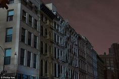 Lights out: The varying shades of the night's sky is all that lit up the West Village during the Hurricane Sandy blackout at the end of October