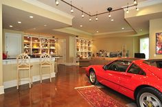 garage - homes with unbelievable garages - equipped with everything from a bar and lounge area to shelves for auto-related memorabilia.