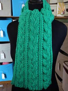 """This is the Braid Cable Reversible Hiking Scarf pattern that I found on Ravelry, knitted with Red Heart Classic 100% acrylic yarn in """"Emerald."""" Another one of those patterns I like because-- like it says-- the scarf looks the same on both sides."""