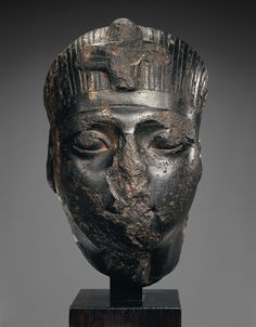 Crushed face of Ancient Egyptian King Notice how his features were destroyed maybe to hide his race. Lips and nose smashed.