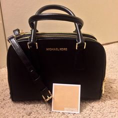 Michael Kors black saffiano satchel Saffiano leather in great condition except for one spot in lining and scratch on back zipper as pictured only used a handful of times it's a gorgeous MK bag MICHAEL Michael Kors Bags Satchels