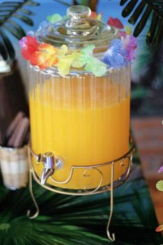 If you'd rather keep it simple then fill a drinks dispenser with some juice and decorate it with a lei. The colors from the flowers help create a Hawaiian vibe! See more party ideas and share yours at CatchMyParty.com Hawaii Birthday Party, Luau Theme Party, Aloha Party, Hawaiian Luau Party, Hawaiian Birthday, Tiki Party, Tropical Party, 2nd Birthday Parties, Beach Party