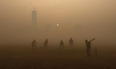 smog & cricket Photograph: Rupak De Chowdhuri/Reuters