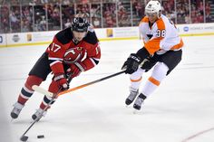 CrowdCam Hot Shot  New Jersey Devils right wing Michael Ryder skates  Philadelphia Flyers defenseman Oliver Lauridsen during the first period at  the ... 0f0aa7d56