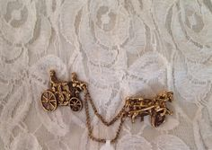 You will get this double brooch attached to a gold tone chain. Definitely a Mid Century piece.