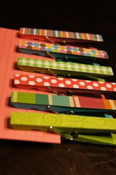 Paint clothespins, cut scrapbook paper to fit mod podge it to the clothes pin let dry and add a magnet strip to the back