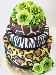 "Watching ""Say Yes To The Dress"" and saw an awesome animal print wedding cake that Brianna said she wanted for her wedding. While searching online for the cake (didn't find it) I thought it would be a great idea for her Sweet 16 or Quinceanera(whichever we throw for her)"