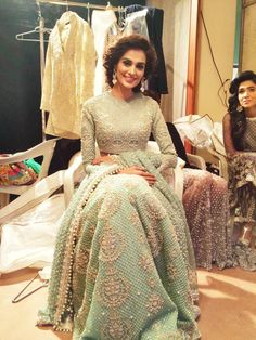 I love this light green/mint colour lengha with the silver embellishments. Although the work is quite heavy the lengha has a real lightness to it