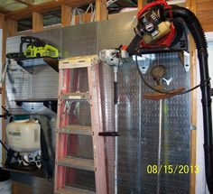 Industrial metal pegboard wall with pegboard panels attached to studs on 16in centers. Heavy items like ladders, leaf blowers, and chainsaws are no problem for Wall Control's industrial strength metal pegboard.