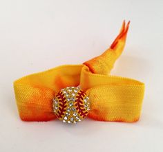 I love these softball hair ties they are so cute !!!!!