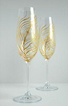 Gold Peacock Feather Wedding Toast Flutes. Available from MaryElizabethArts.com