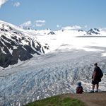 Hikers overlook Exit Glacier at the Top of the Cliffs along the Harding Icefield Trail (Alaska)