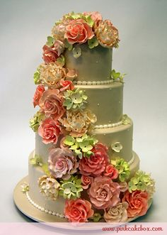 Gorgeous sugar flower cake - love the shades of spring greens, peach, blush pink and cream