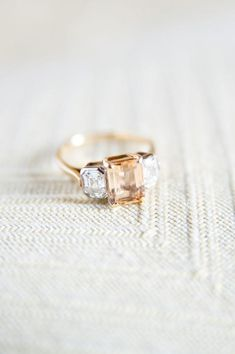 peachy nude gemstone engagment ring flanked by diamonds @myweddingdotcom