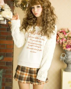 Gyaru kei. Just trying to disregard the horribly grammatical incorrectness of that adorable sweater.