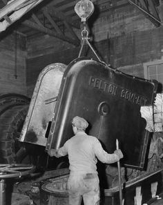 Pelton waterwheel being disassembled at the River Power House, 1942. In 1944 the power plant was being sent to Chile when, en route, the ship it was being transported on was sunk by torpedoes during World War II. Public Utilities History Center. San Fernando Valley History Digital Library.