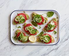 Dressed up with thinly sliced tomatoes and cucumber, greens, and alfalfa sprouts, this vegan avocado toast makes a perfect portable snack or breakfast.
