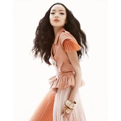 Xiao Wen Ju Poses for Greg Kadel in Pastels for Vogue China March 2013 ❤ liked on Polyvore