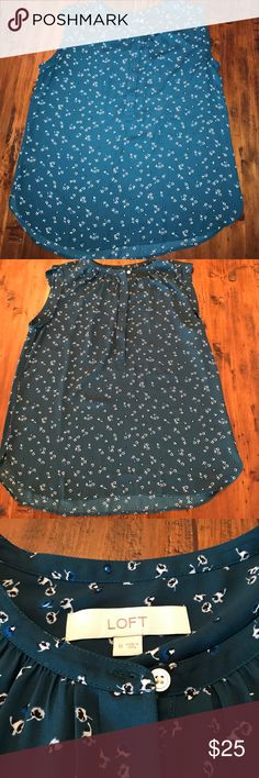 """Loft Sleeveless Blouse This Sleeveless Blouse from Loft is size medium. It is a dark turquoise with a white, black, and blue Floral design. It is in excellent condition- worn once.  The front has 5 buttons- all but the top are covered. That detail is approx 12"""". Bust measures approx 19.5"""" and length is approx 25.5"""". It is 0.5 to 1 inch longer in back. Arm hole is cuffed. *cat friendly, smoke free home* LOFT Tops Blouses"""