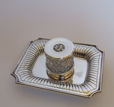A handsome Victorian silver desk inkwell.