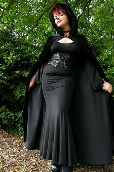"""This gorgeous black floor length silky skirt features a sexy low rise and elasticized waist. Approx. length: 42"""". Poly/spandex. Machine wash.    Scroll to the bottom of this page for other related items       Model: Jessica Photo by John M Studios"""